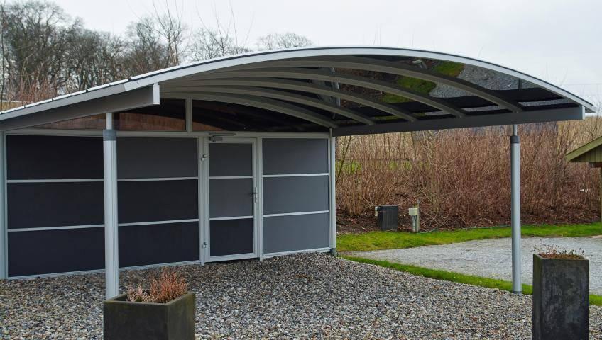 A metal carport staged outside.